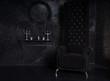 Black High Back Chair in Eerie Halloween Setting