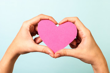 Pink love shape on blue background
