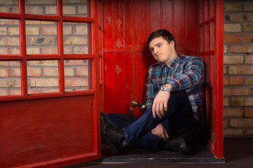 Frustrated young man waiting for a telephone call