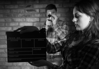 Woman Holding Clapper Board In Front Photographer