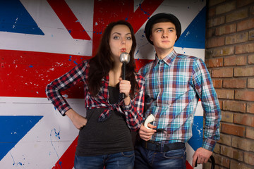 Young Couple in Casual Outfit in Front UK Flag