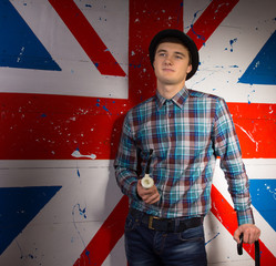 Man in Trendy Fashion In Front Britain Flag