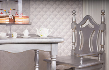 Silver Chair at Dining Table Set for Tea with Cake
