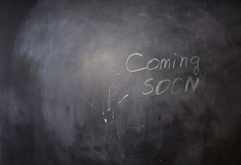 Coming Soon Texts on Black Chalkboard