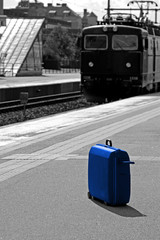 Blue suitcase at the station