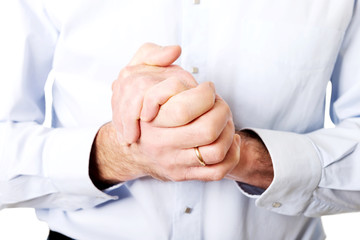 Close up on male clenched hands