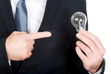 Close up on businessman hand with light bulb
