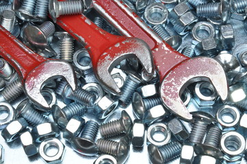 Wrenches with nuts and bolts on metal surface