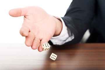 Close up male hand with dices on double sixes