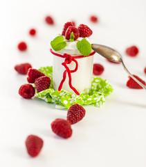 Raspberries and yoghurt or clotted cream