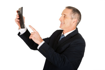 Businessman pushing the button on calculator
