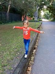 little boy balancing - fairchild gardens