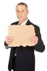 Businessman holding a piece of cardboard