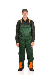 Mature gardener standing in uniform