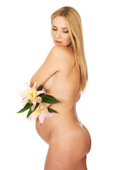 Pregnant woman holding a lily flower