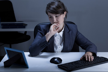 Thoughtful woman in the office