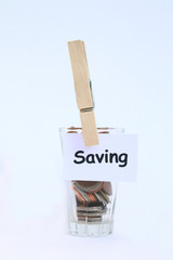 coin in glass and saving tag