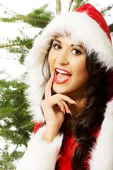 Portrait of santa woman with christmas tree