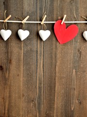 Red heart and white hearts with clothes pins