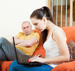 Sad guy and woman with laptop during conflict