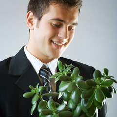 Businessman or student with flowerpot