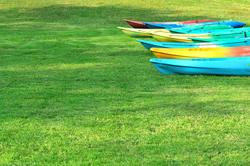Canoeing the many colorful arranged on the lawn.