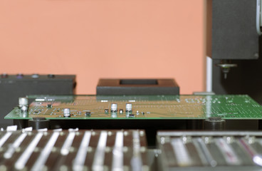 Electronic printed circuit Board on the table of the robot manip