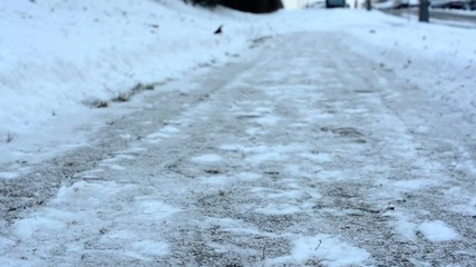clear winter sidewalk - pavement with snow