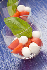 Tomato Mozzarella appetizer in glass - Caprese