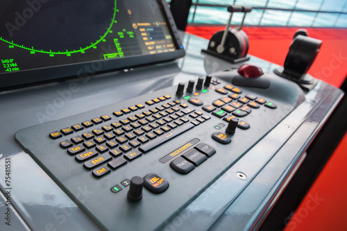 Modern ship control panel with radar screen