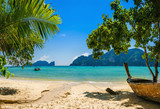 Exotic beach with palms and boats on azure water, Phi Phi Island - 75482924