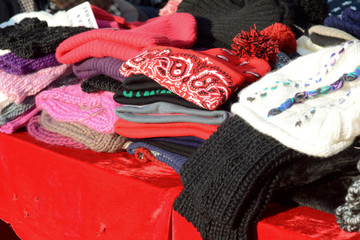 Stack of winter hats at market stall