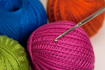 Colored yarn balls with crochet hook