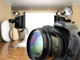 Fototapety DSLR camera in photo studio with lighting equipment, softbox and