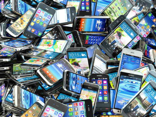 Mobile phones background. Pile of different modern smartphones. - 75486712