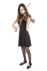teenage girl plays violin in studio