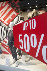 sale in shopping window of clothes store