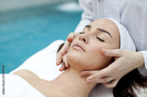 Woman receiving spa treatment  - 75488768