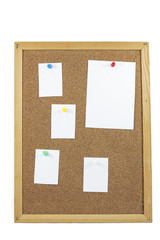 cork board with blank paper notes