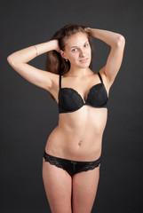 Positive slender graceful girl in lingerie