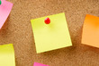 Pinned color notes on an corkboard
