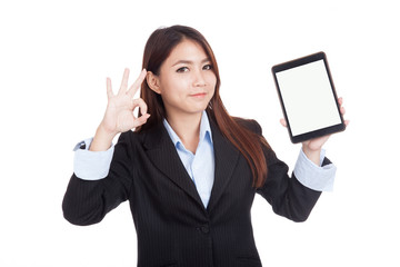 Young Asian businesswoman show ok with tablet pc