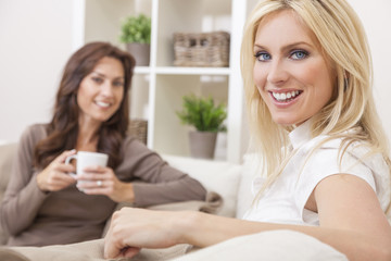 Two Women Friends Drinking Tea or Coffee at Home