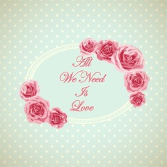 Vintage card with phrase all we need is love.