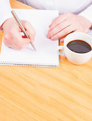 Hands writing with coffee, planning concept