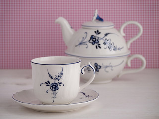 Vintage teacup and teapot with floral motif