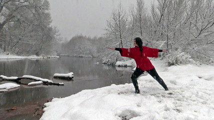 Woman Practicing Yoga in Snowstorm