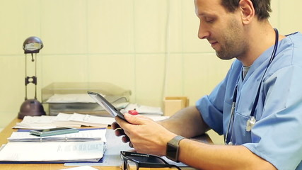 Male doctor working with tablet in the office