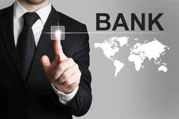 businessman pushing button bank global