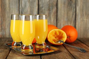 Glass of orange juice with slices